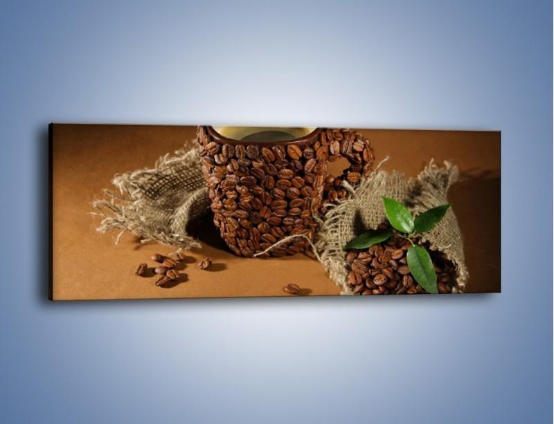 Obraz na płótnie – Kubek z ziarnami kawy – jednoczęściowy panoramiczny JN388