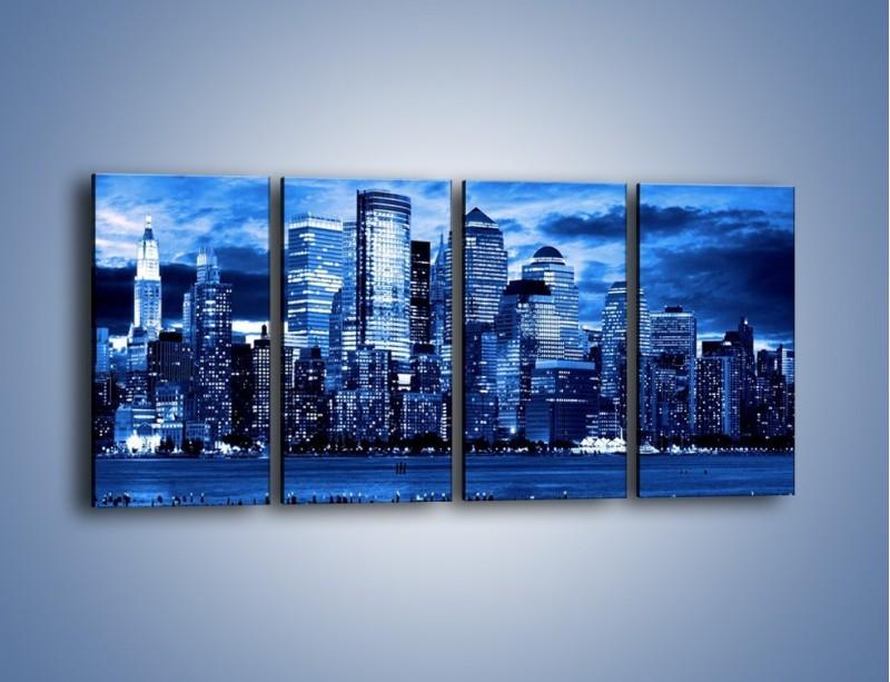 Obraz na płótnie – Wieżowce w odcieniach niebieskiego – czteroczęściowy AM017W1