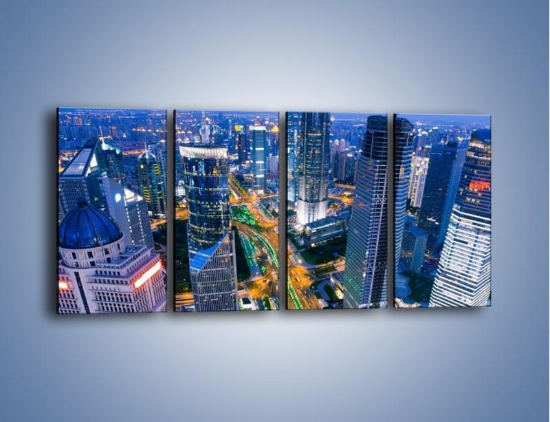 Obraz na płótnie – Oświetlone miasto wczesnym wieczorem – czteroczęściowy AM026W1