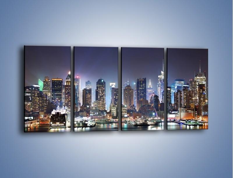 Obraz na płótnie – Oświetlone miasto nocą – czteroczęściowy AM034W1