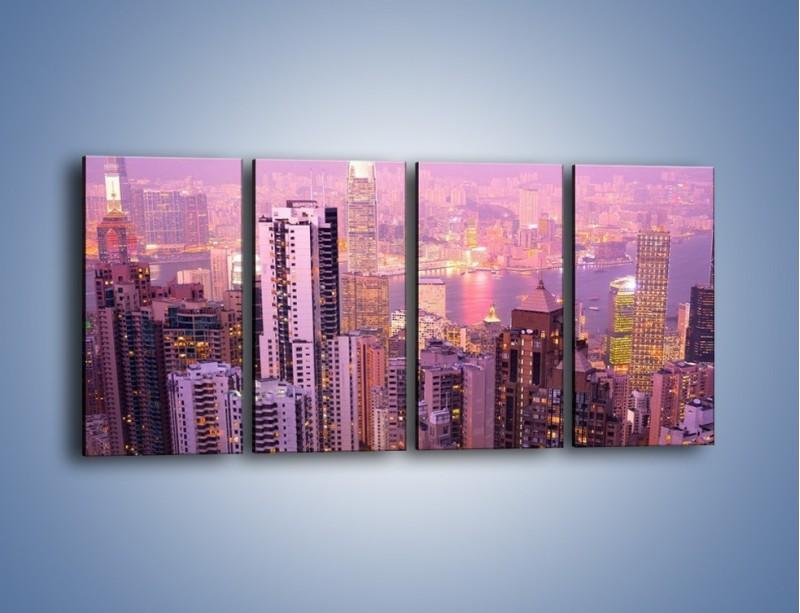 Obraz na płótnie – Duże miasto budzące się o poranku do życia – czteroczęściowy AM062W1