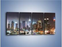 Obraz na płótnie – Oświetlone miasto nocą nad wodą – czteroczęściowy AM103W1