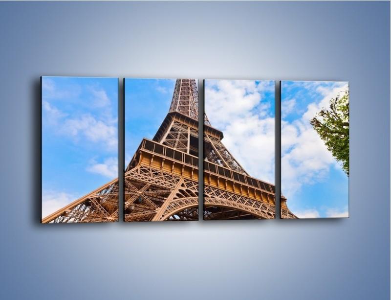 Obraz na płótnie – Wieża Eiffla pod chmurkami – czteroczęściowy AM173W1