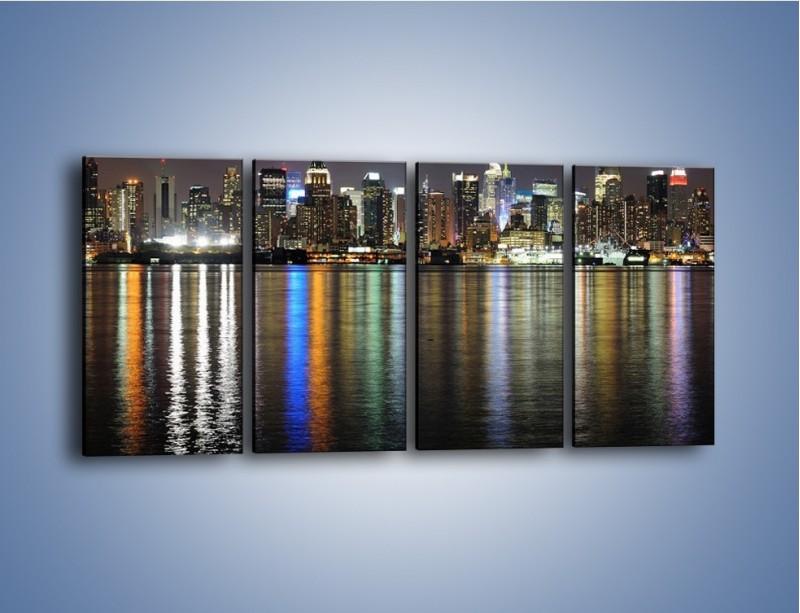 Obraz na płótnie – Światła miasta w lustrzanym odbiciu wody – czteroczęściowy AM222W1