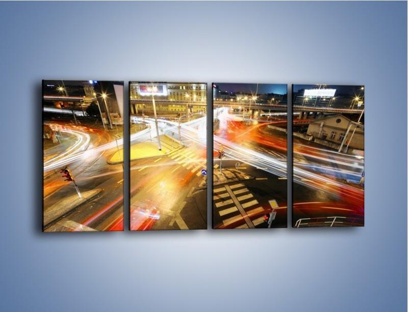 Obraz na płótnie – Światła samochodów w ruchu na skrzyżowaniu – czteroczęściowy AM279W1