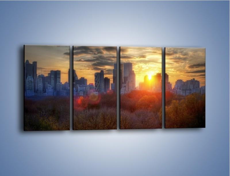 Obraz na płótnie – Wschód słońca nad miastem – czteroczęściowy AM318W1
