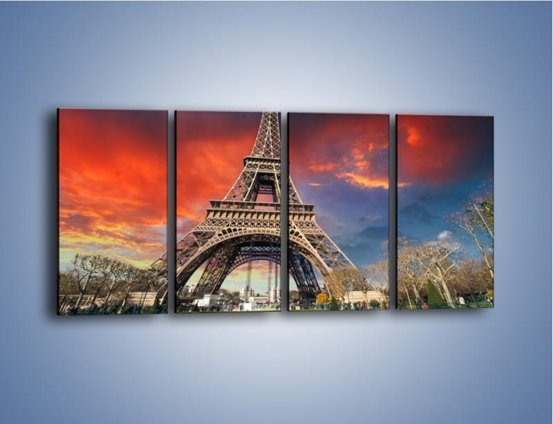 Obraz na płótnie – Wieża Eiffla pod niebiesko-czerwonym niebem – czteroczęściowy AM463W1