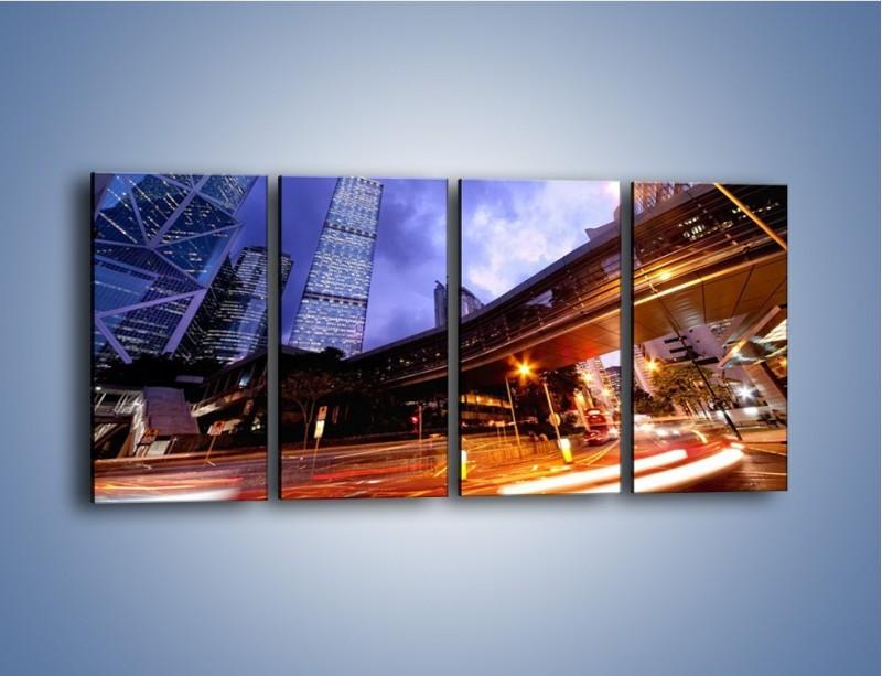 Obraz na płótnie – Drapacze chmur i wieczorny ruch uliczny – czteroczęściowy AM487W1