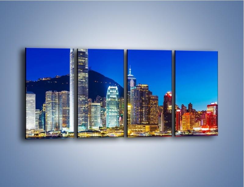 Obraz na płótnie – Oświetlone wieżowce Hong Kongu – czteroczęściowy AM498W1