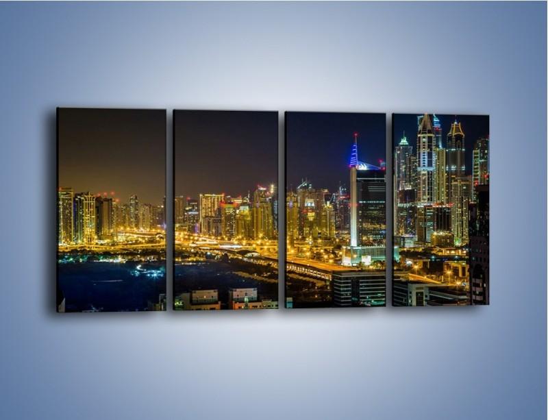 Obraz na płótnie – Oświetlony Dubaj nocą – czteroczęściowy AM506W1
