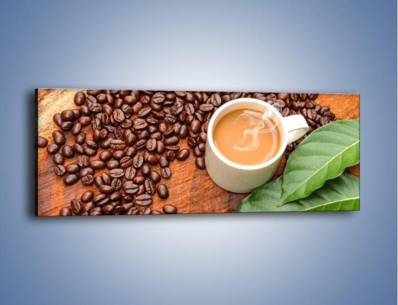 Obraz na płótnie – Ziarna kawy pod liściem – jednoczęściowy panoramiczny JN417