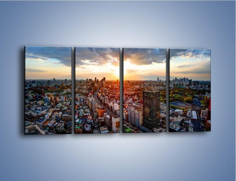 Obraz na płótnie – Panorama miasta o zachodzie słońca – czteroczęściowy AM587W1