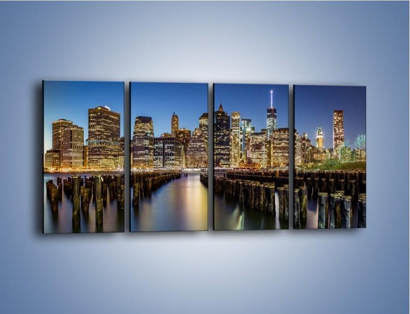Obraz na płótnie – Zniszczone molo i widok na Manhattan – czteroczęściowy AM601W1