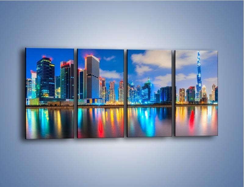 Obraz na płótnie – Kolory Dubaju odbite w wodzie – czteroczęściowy AM740W1