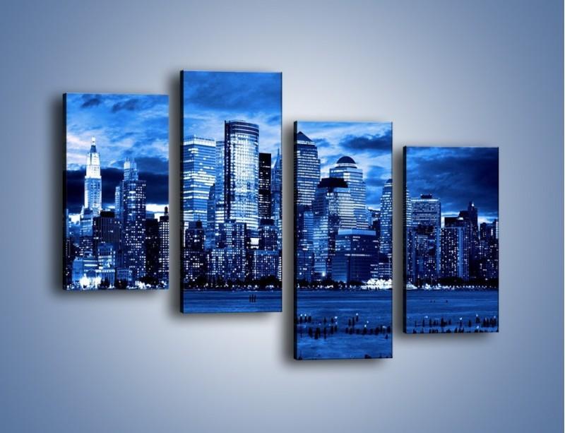 Obraz na płótnie – Wieżowce w odcieniach niebieskiego – czteroczęściowy AM017W2