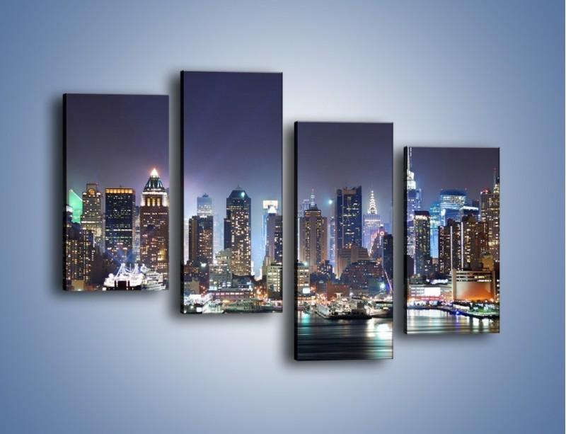 Obraz na płótnie – Oświetlone miasto nocą – czteroczęściowy AM034W2