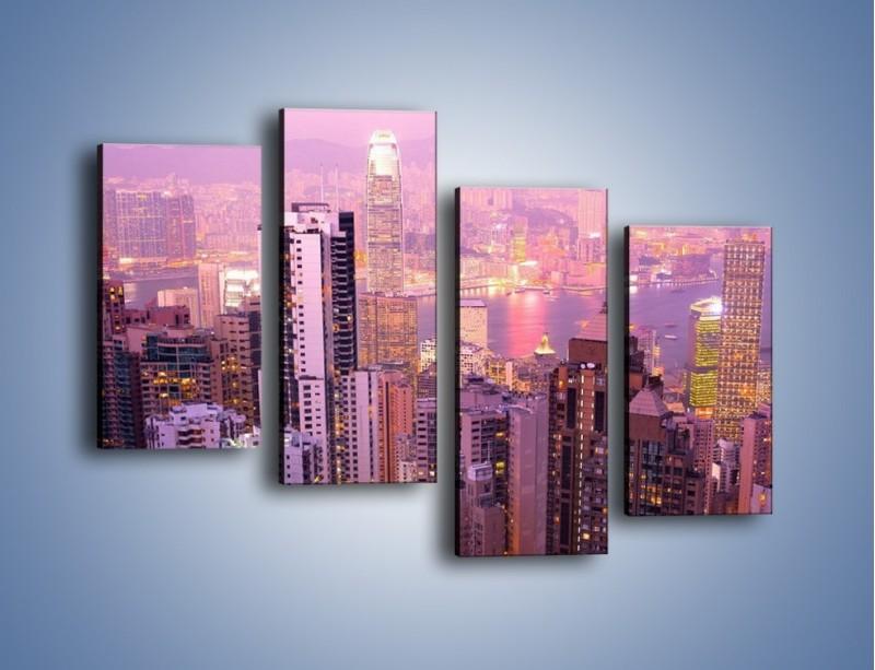 Obraz na płótnie – Duże miasto budzące się o poranku do życia – czteroczęściowy AM062W2