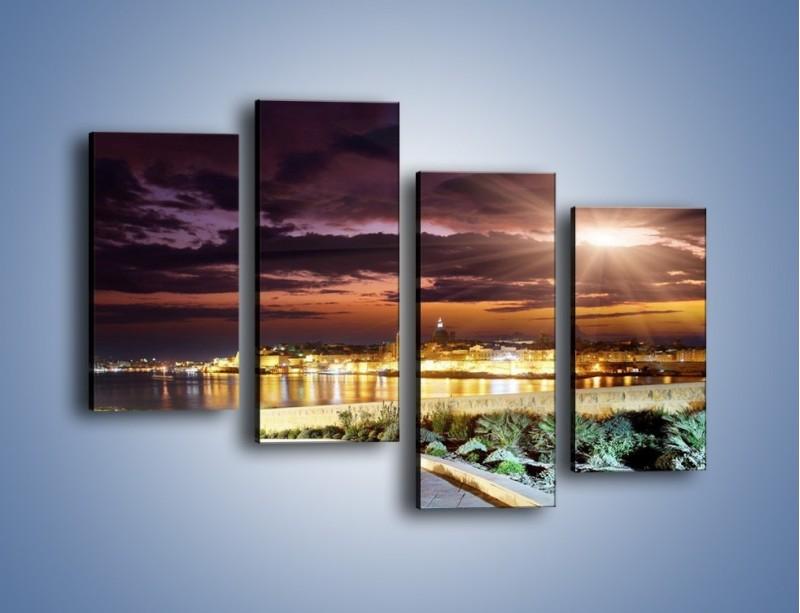 Obraz na płótnie – Błysk światła nad miastem wieczorową porą – czteroczęściowy AM063W2