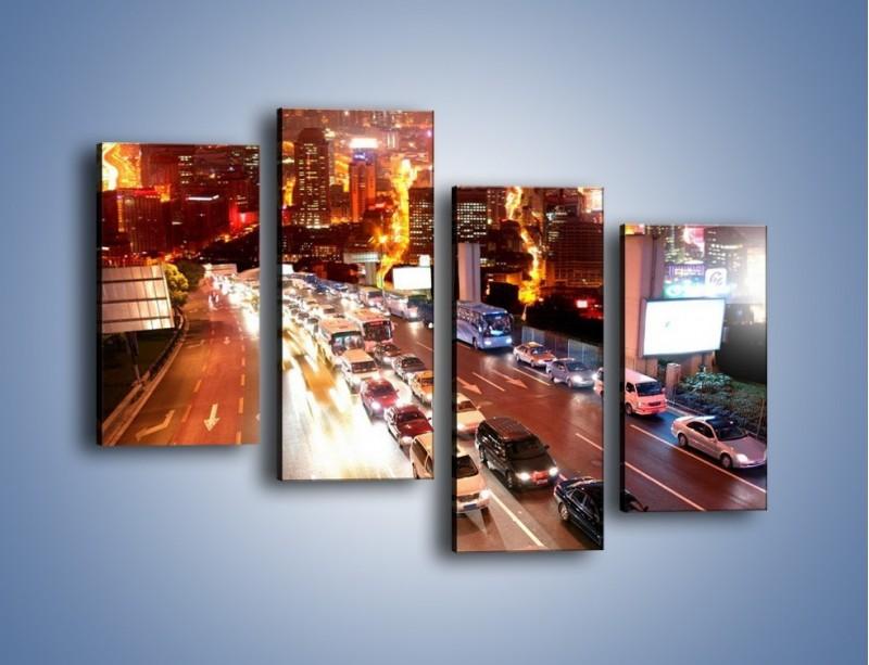 Obraz na płótnie – Wyjazd z zatłoczonego miasta – czteroczęściowy AM080W2