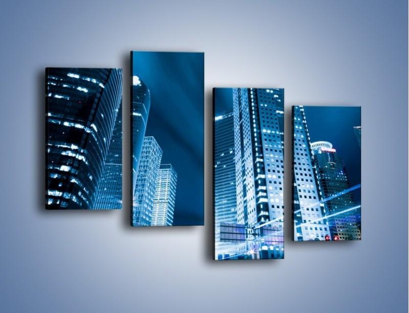 Obraz na płótnie – Wieżowce w mieście nocą – czteroczęściowy AM216W2