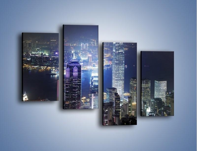 Obraz na płótnie – Miasto oświetlone nocą – czteroczęściowy AM223W2