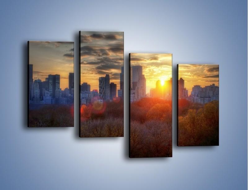 Obraz na płótnie – Wschód słońca nad miastem – czteroczęściowy AM318W2