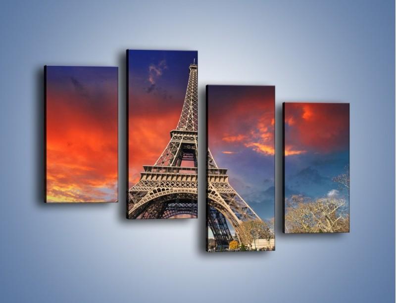 Obraz na płótnie – Wieża Eiffla pod niebiesko-czerwonym niebem – czteroczęściowy AM463W2