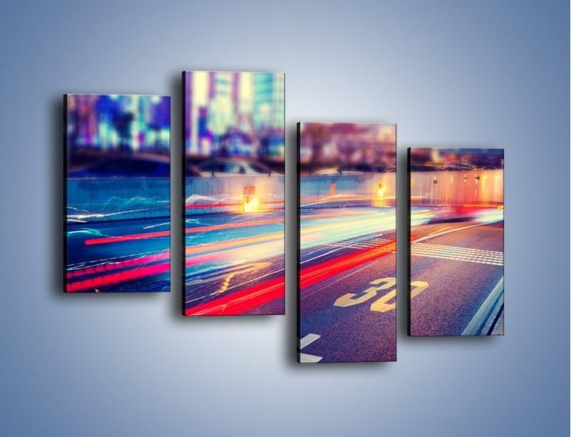 Obraz na płótnie – Ulica w ruchu świateł samochodowych – czteroczęściowy AM482W2