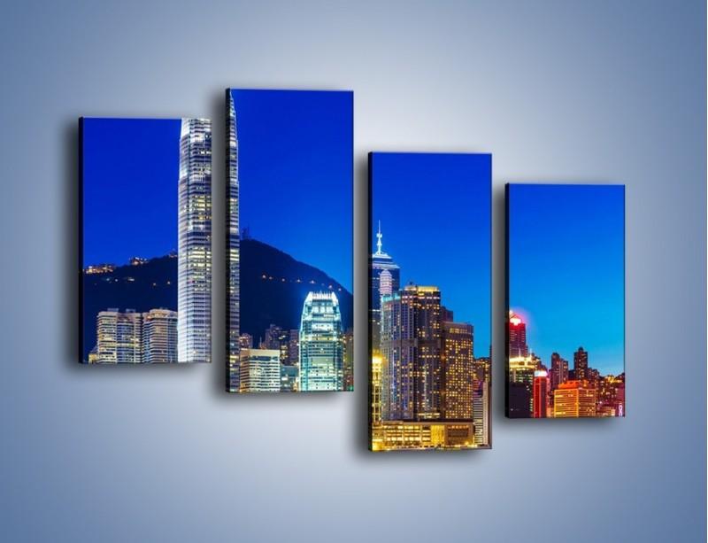 Obraz na płótnie – Oświetlone wieżowce Hong Kongu – czteroczęściowy AM498W2