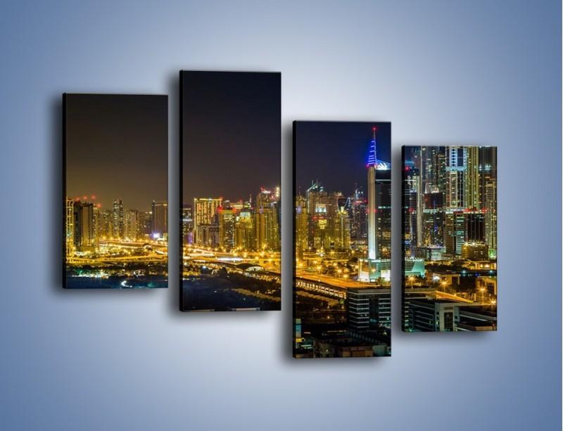 Obraz na płótnie – Oświetlony Dubaj nocą – czteroczęściowy AM506W2
