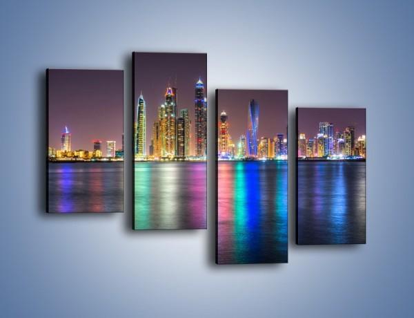 Obraz na płótnie – Kolorowe drapacze chmur w Dubaju – czteroczęściowy AM724W2