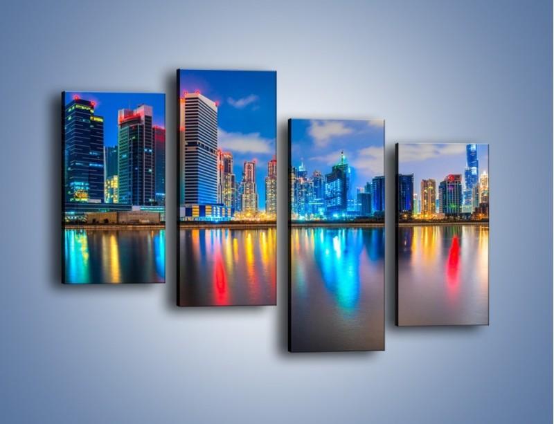 Obraz na płótnie – Kolory Dubaju odbite w wodzie – czteroczęściowy AM740W2