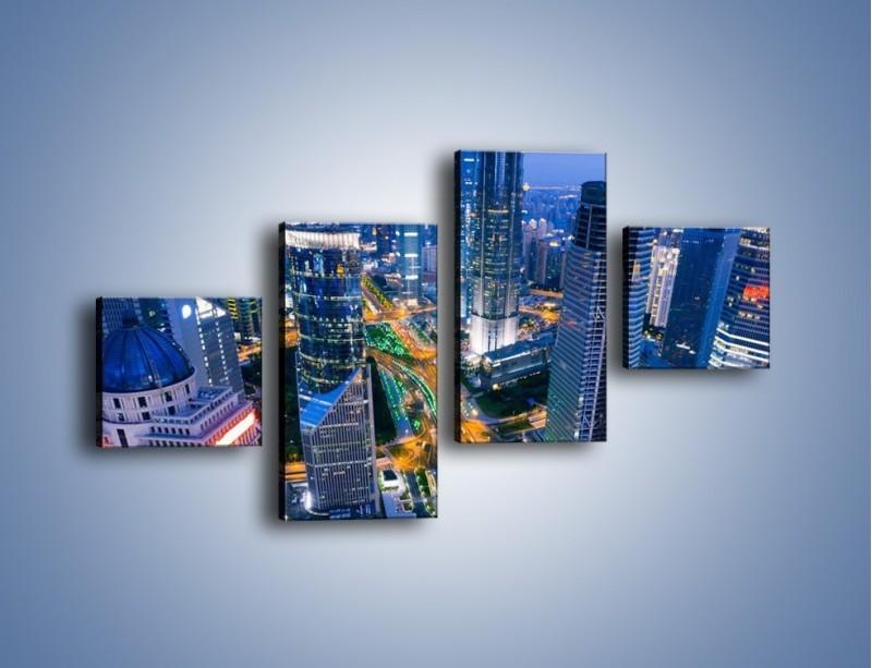 Obraz na płótnie – Oświetlone miasto wczesnym wieczorem – czteroczęściowy AM026W3