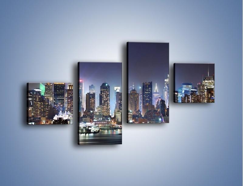 Obraz na płótnie – Oświetlone miasto nocą – czteroczęściowy AM034W3
