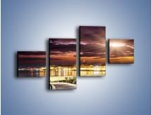 Obraz na płótnie – Błysk światła nad miastem wieczorową porą – czteroczęściowy AM063W3