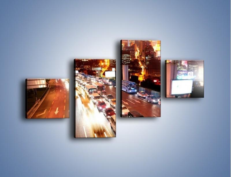 Obraz na płótnie – Wyjazd z zatłoczonego miasta – czteroczęściowy AM080W3