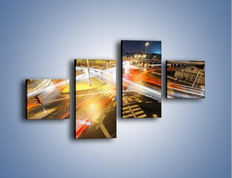 Obraz na płótnie – Światła samochodów w ruchu na skrzyżowaniu – czteroczęściowy AM279W3