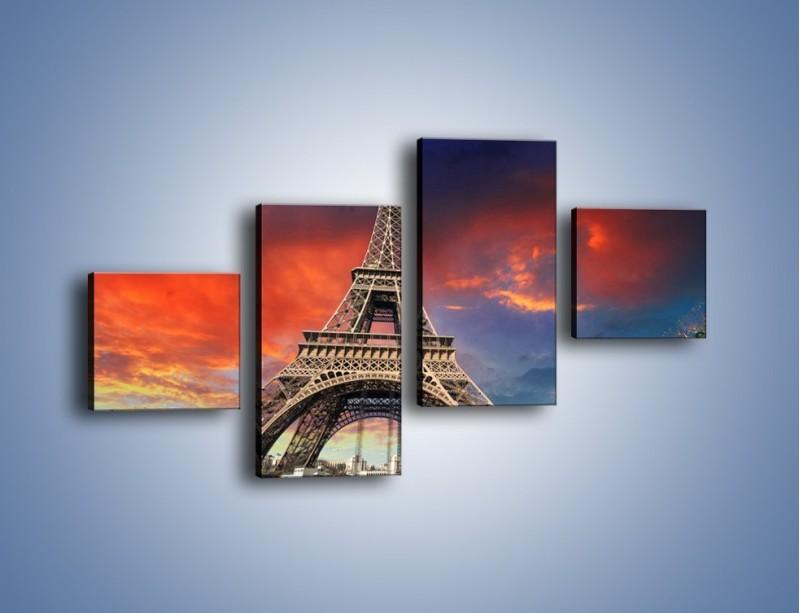 Obraz na płótnie – Wieża Eiffla pod niebiesko-czerwonym niebem – czteroczęściowy AM463W3