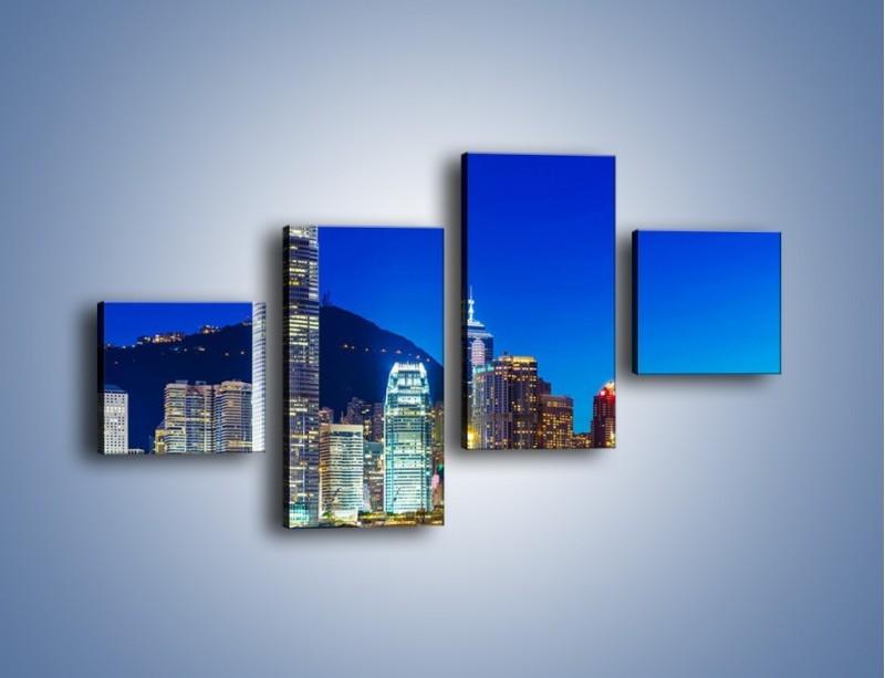 Obraz na płótnie – Oświetlone wieżowce Hong Kongu – czteroczęściowy AM498W3