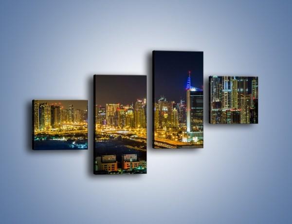 Obraz na płótnie – Oświetlony Dubaj nocą – czteroczęściowy AM506W3
