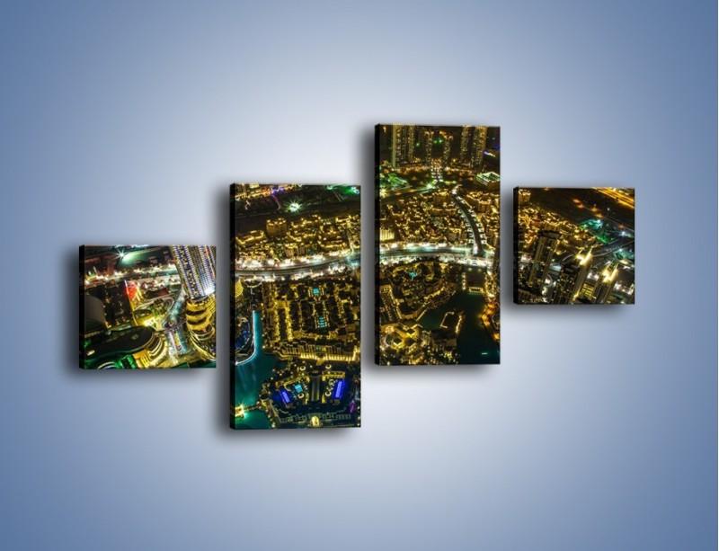 Obraz na płótnie – Dubaj nocą z lotu ptaka – czteroczęściowy AM507W3