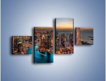 Obraz na płótnie – Centrum Dubaju wieczorową porą – czteroczęściowy AM656W3