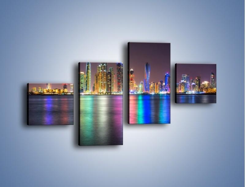 Obraz na płótnie – Kolorowe drapacze chmur w Dubaju – czteroczęściowy AM724W3