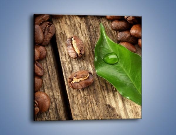 Obraz na płótnie – Ziarna kawy obok liścia – jednoczęściowy kwadratowy JN382