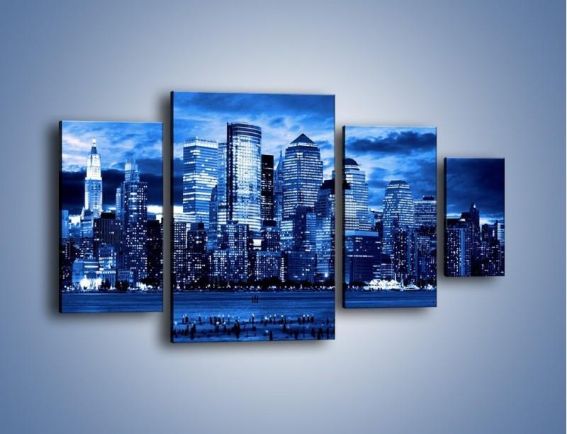 Obraz na płótnie – Wieżowce w odcieniach niebieskiego – czteroczęściowy AM017W4