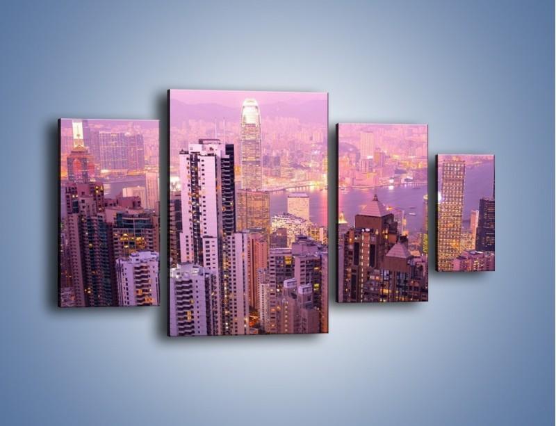 Obraz na płótnie – Duże miasto budzące się o poranku do życia – czteroczęściowy AM062W4