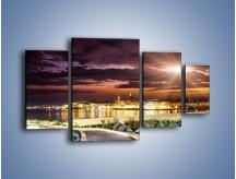 Obraz na płótnie – Błysk światła nad miastem wieczorową porą – czteroczęściowy AM063W4