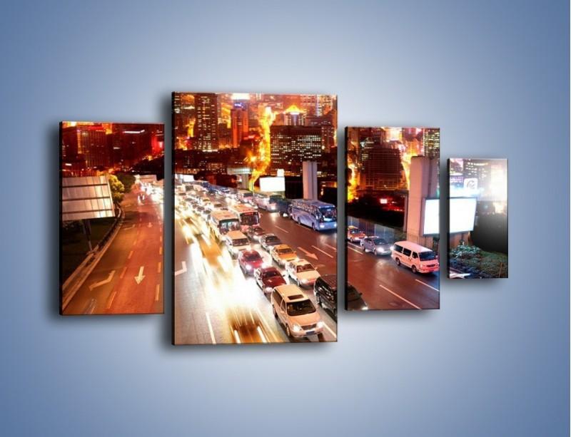 Obraz na płótnie – Wyjazd z zatłoczonego miasta – czteroczęściowy AM080W4