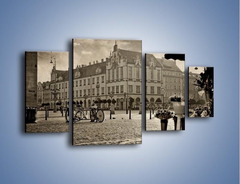 Obraz na płótnie – Rynek Starego Miasta w stylu vintage – czteroczęściowy AM138W4