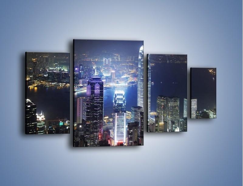 Obraz na płótnie – Miasto oświetlone nocą – czteroczęściowy AM223W4